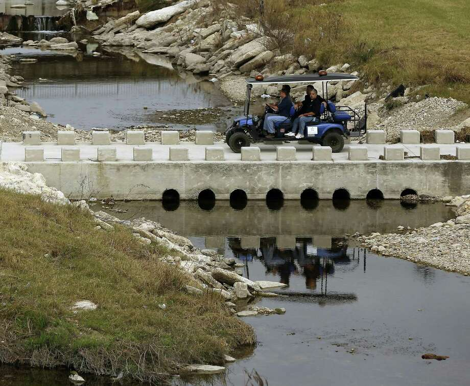 A San Antonio River Authority vehicle crosses Alazan Creek on Jan. 5 on the Apache Creek Trailway, just upstream from the intersection of the two waterways. Photo: William Luther /San Antonio Express-News / © 2017 San Antonio Express-News