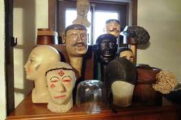 A collection of old wooden mannequin heads sits on Lanfear's dresser.