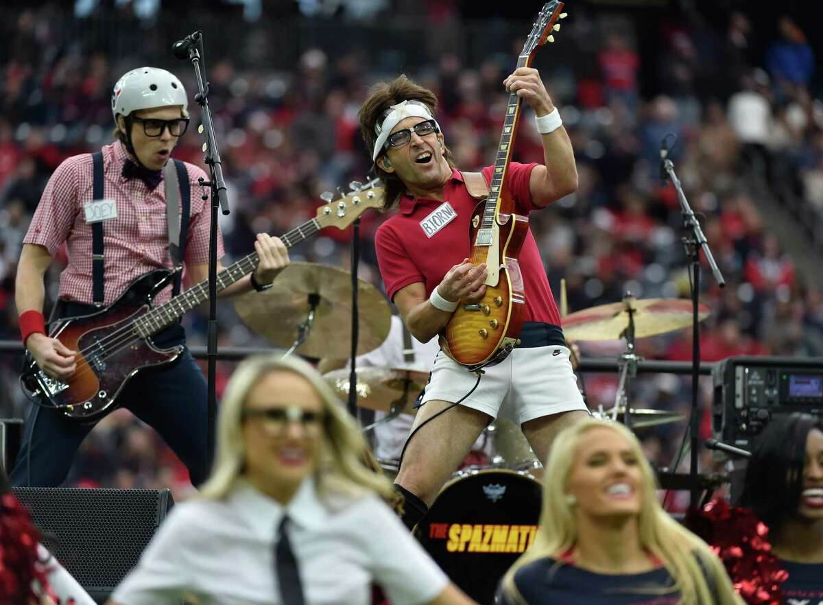 The Spazmatics perform at half-time an NFL football game Sunday, Dec. 18, 2016, in Houston. (AP Photo/Eric Christian Smith)