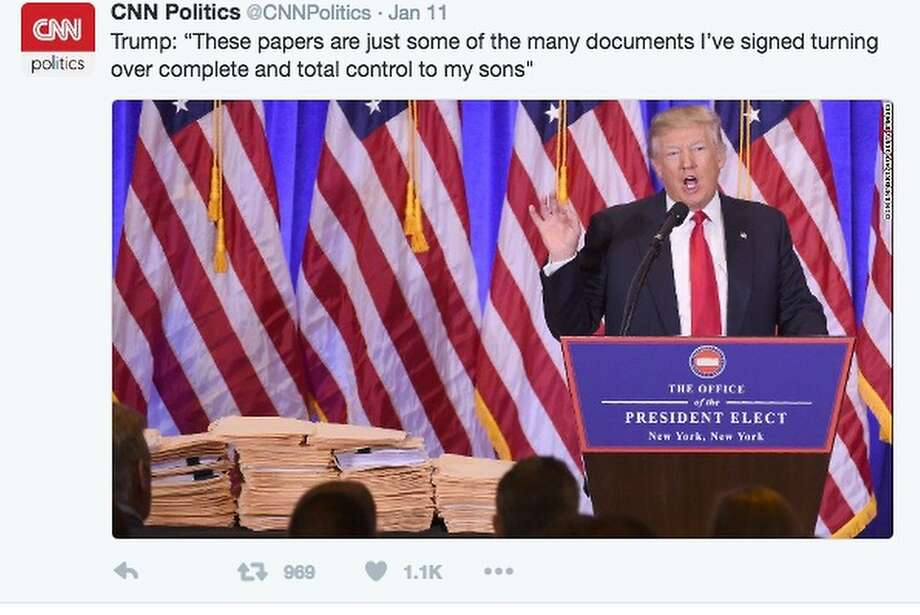 Trump said he signed the papers in these stacks of folders, which his staff brought to Wednesday's press conference. The documents supposedly relate to his plan to turn over his businesses to his sons. Photo: CNN/Twitter