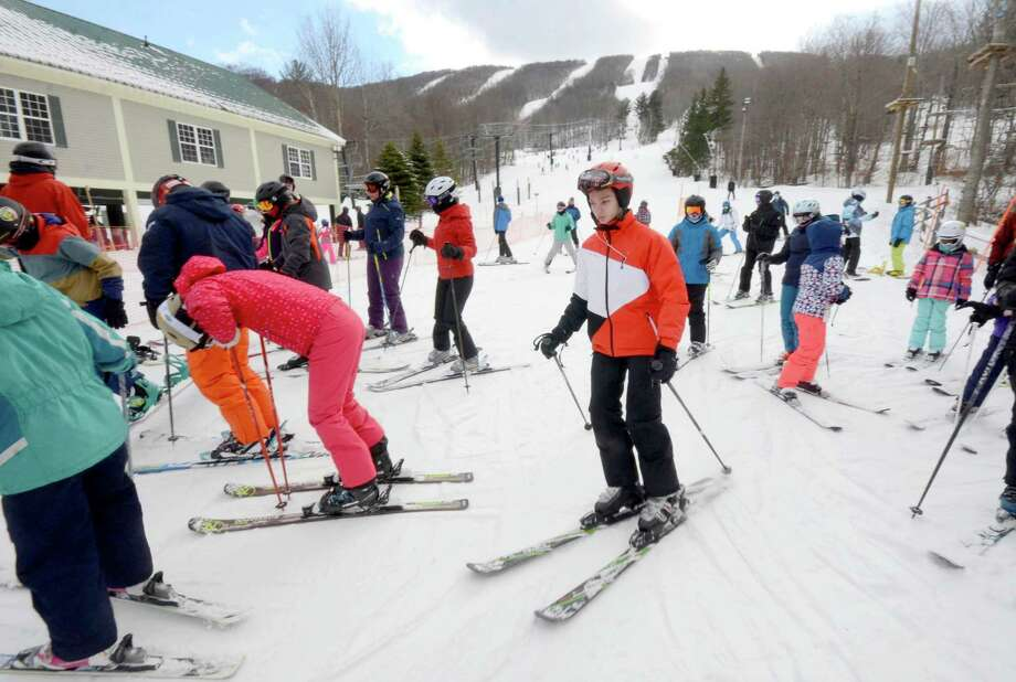 Skiers took to the slopes to enjoy the conditions at Jiminy Peak Mountain Resort in Hancock, Mass., Sunday, Jan. 1, 2017. While crowds were typically smaller, people weren't complaining. And compared to last year, which lacked any snow, ski resorts were reporting a brisk business even if they were not breaking any records.  (Gillian Jones/The Berkshire Eagle via AP) ORG XMIT: MAPIT104 Photo: Gillian Jones, AP / The Berkshire Eagle