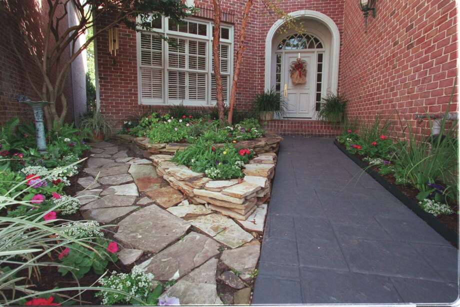 The pie-shaped entry garden of Harriet Foster's townhome, shot 12/19/00 for TexMag. HOUCHRON CAPTION (01/21/2001): A terraced flower bed, varying hardscapes and seasonal blooms make an inviting entrance to this Houston townhome. Photo: Houston Chronicle File Photo / Houston Chronicle