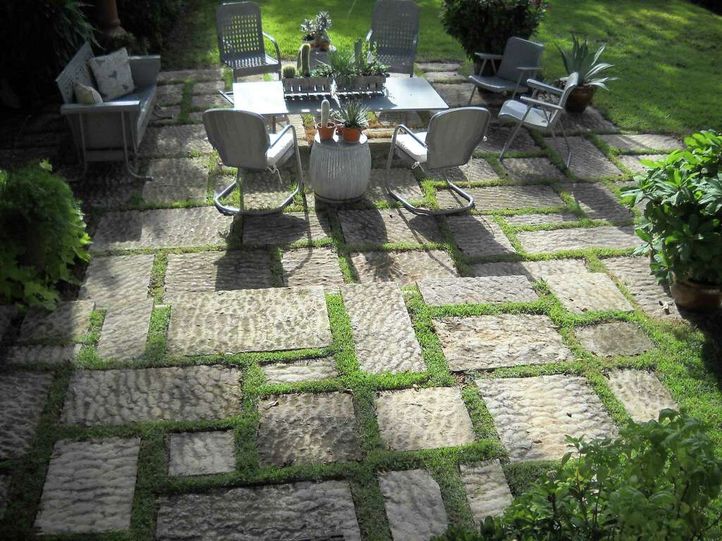 Zoysia Grass Growing Between Stones Softens The Look Of A Rock Patio. The  Wide Spaces