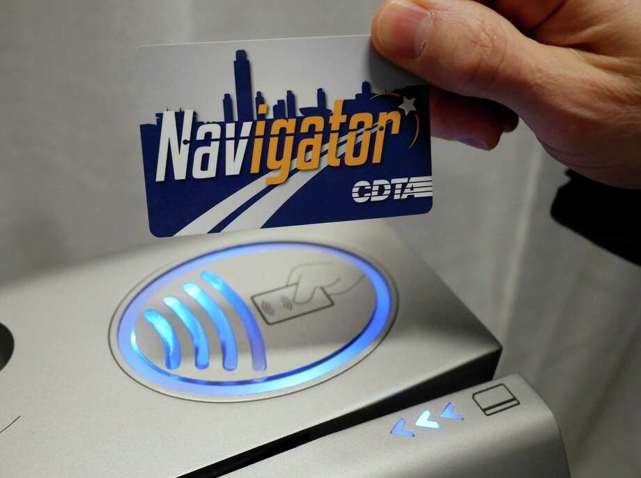 A CDTA Navigator smart card is held above the reader on a fare box during an event to launch the Navigator program to the public on Thursday, Jan. 12, 2017, in Albany, N.Y.  Riders using the smart card will place the card onto the reader to pay for fares.      (Paul Buckowski / Times Union) Photo: PAUL BUCKOWSKI / 20039374A