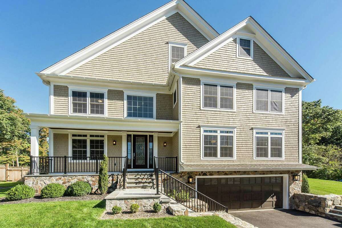 The newly constructed colonial at 48 Clinton Ave. sits on a corner lot of a third of an acre at the corner of Fillow Street.