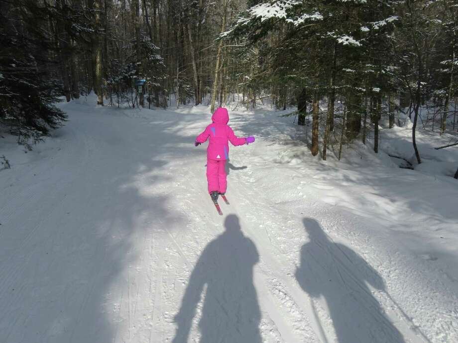 """Little Wren uses swinging """"gorilla arms"""" while practicing her cross-country ski technique at Lapland Lake Nordic Vacation Center in Benson. (Herb Terns / Times Union)"""