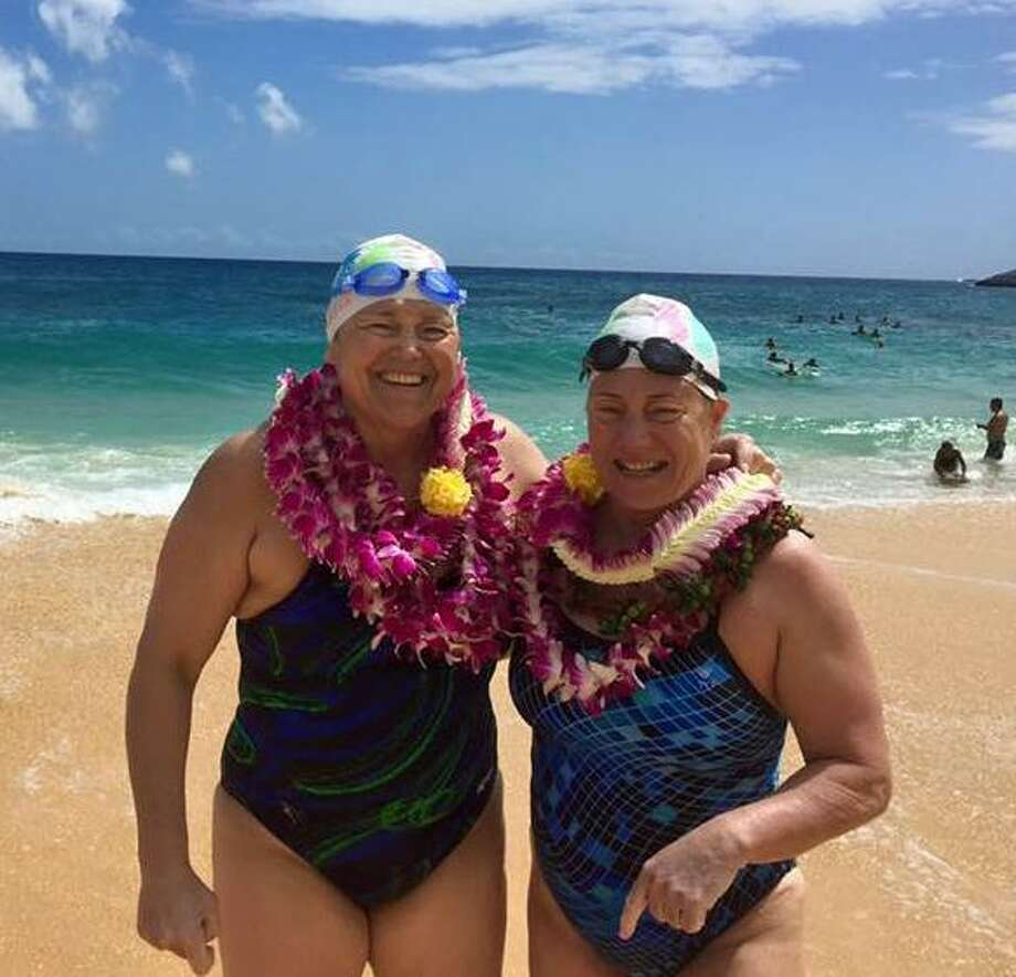 Westport's Elizabeth Fry (right) swam 17 hours and 30 minutes across the 42 kilometerMolokai Channel. Photo: Contributed / Photo