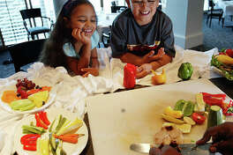Preparing and eating healthy meals together is one of the best ways for parents to create a positive body image for their children.