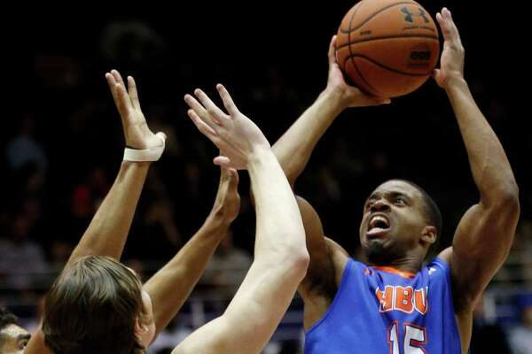 Houston Baptist guard/forward Reveal Chukwujekwu, right, shoots against Northwestern during the first half of an NCAA college basketball game Thursday, Dec. 22, 2016, in Evanston, Ill. (AP Photo/Nam Y. Huh)