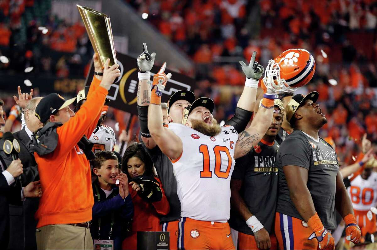 Clemson players celebrate after the NCAA college football playoff championship game against Alabama Tuesday, Jan. 10, 2017, in Tampa, Fla. Clemson won 35-31. (AP Photo/John Bazemore)