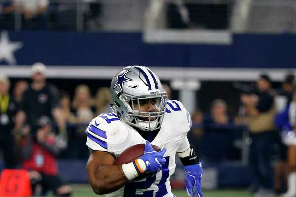Dallas Cowboys' Ezekiel Elliott carries the ball against the Detroit Lions in an NFL football game, Monday, Dec. 26, 2016, in Arlington, Texas. (AP Photo/Michael Ainsworth)