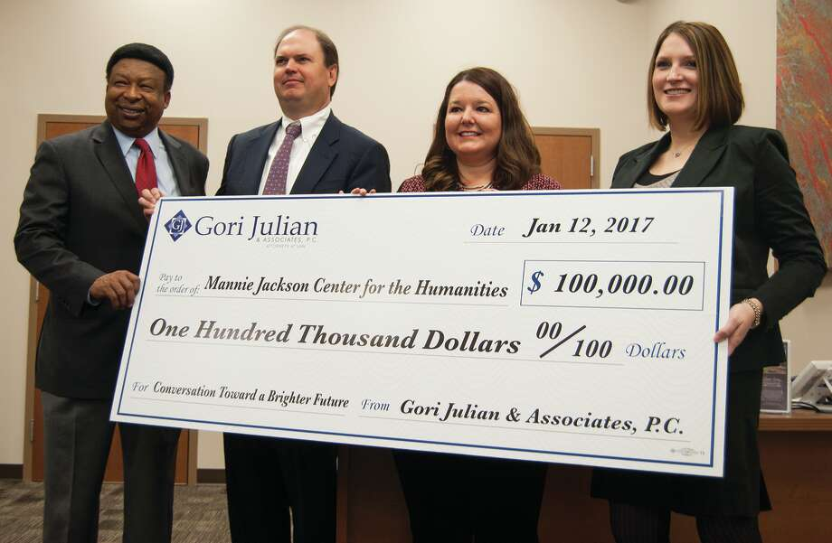 Mannie Jackson Center for the Humanities Foundation Executive Director Ed Hightower and Gori Julian representatives Randy Gori, Beth Gori, and Sara Salger pose with the $100,000 ceremonial check. Photo: Zachary Foote • Intelligencer