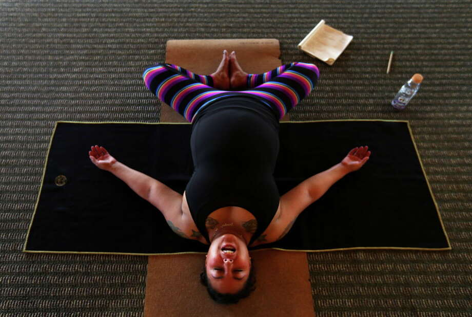 Instructor Gina Miller leads a hot yoga class designed for runners on Sunday, Jan. 8, 2016, at Your Body Center in the Heights. Photo: Annie Mulligan / 2016 Annie Mulligan