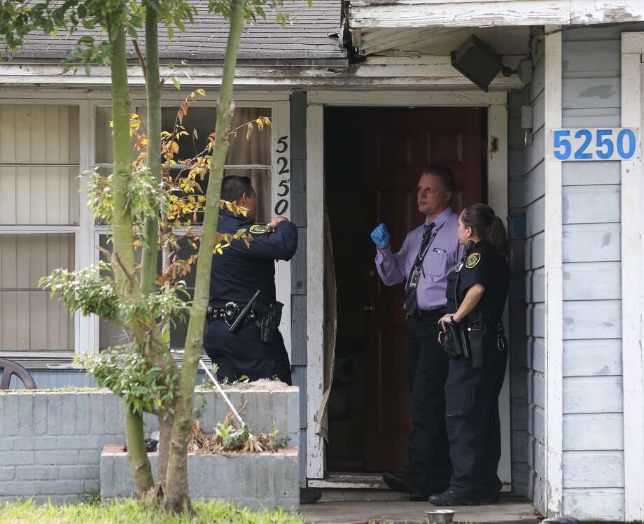 Police officers are investigating a double homicide at 5200 block Dewberry Street on Thursday, January 12, in Houston. (Yi-Chin/ Houston Chronicle)
