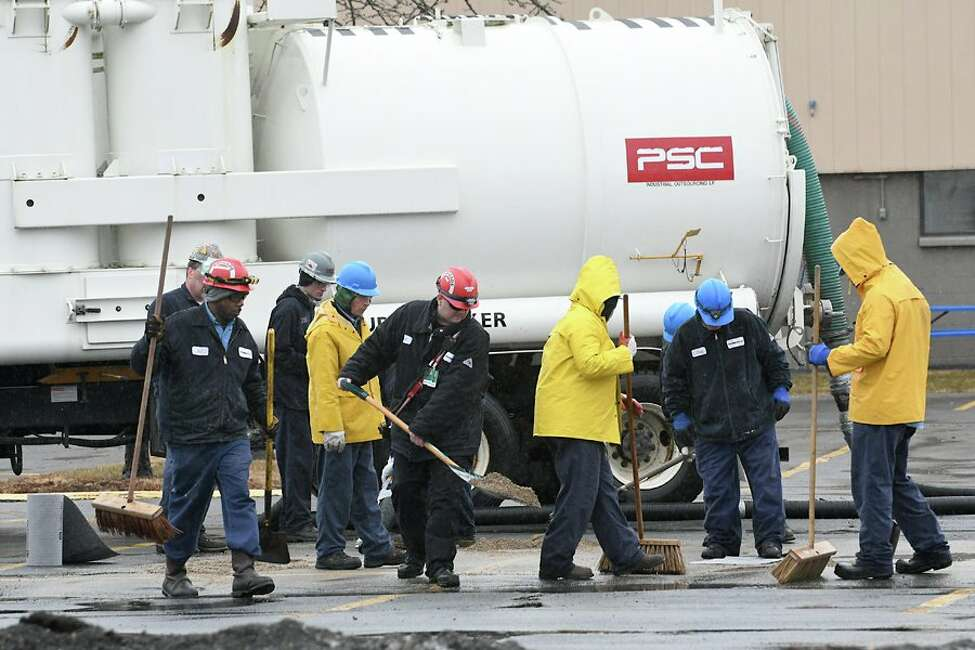 State investigators were at the site of a spill Thursday morning at the Momentive Performance Materials plant, where unionized workers have been off the job since Nov. 2. The spill of an unknown substance, from an arriving truck operated by The Shaker Group, happened about 8 a.m. (Lori Van Buren / Times Union)