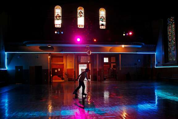 A lone skater warms up at the beginning of disco night at the Church of 8 Wheels on Fillmore Street on March 19, 2014 in San Francisco, Calif. The Church of 8 Wheels is the brainchild of David Miles, Jr. and features roller skating several nights a week in a disused church at 554 Fillmore Street.