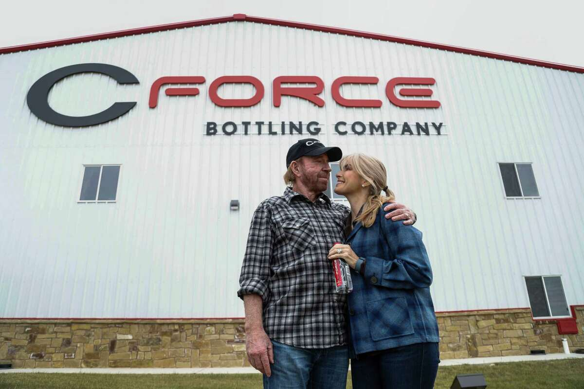 Chuck Norris and his wife, Gena Norris, outside the CForce plant.