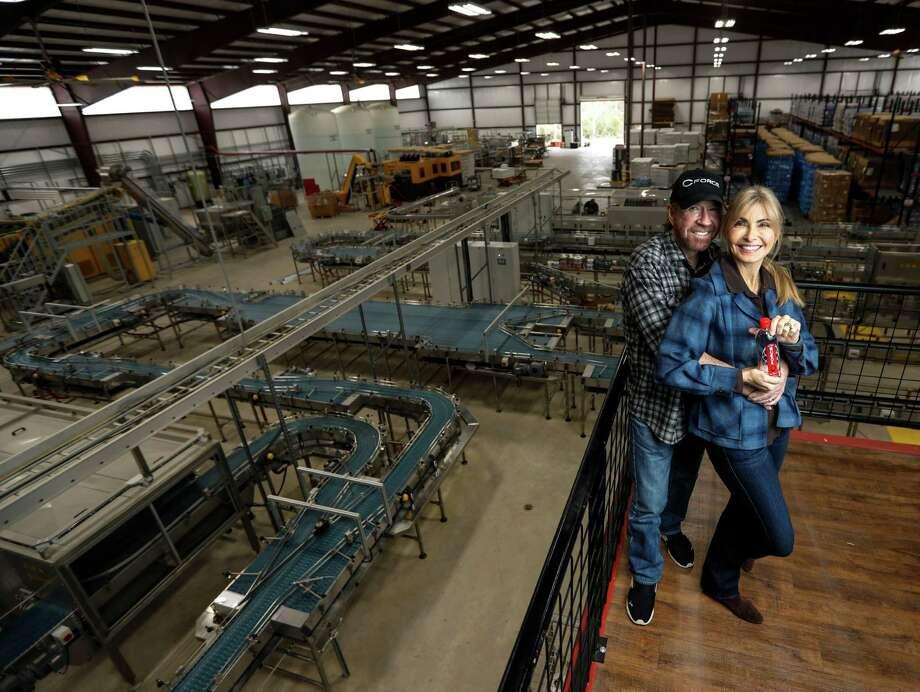 Chuck and Gena Norris, inside the CForce bottling plant. Photo: Karen Warren, Houston Chronicle / 2016 Houston Chronicle