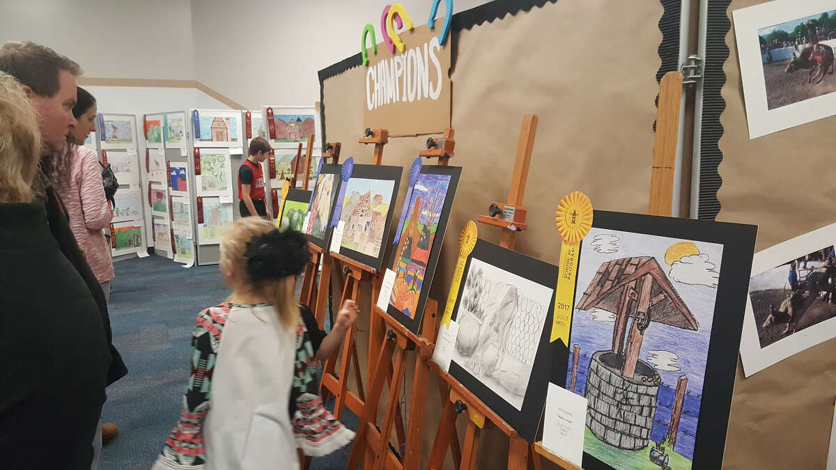 People in attendance during the Huffman ISD Rodeo Art Show at Copeland Elementary School Jan. 9 admire the winning artwork of Huffman ISD students chosen by Houston Livestock Show and Rodeo judges.