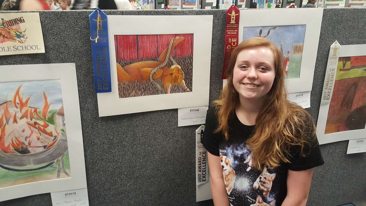 Huffman eighth grader Sophie McGregor poses with her piece during Huffman ISD's Rodeo Art Show Open House at Copeland Elementary School Jan. 9. She was awarded Best of Show for her art submission in last year's Houston Livestock Show and Rodeo School Art Program.