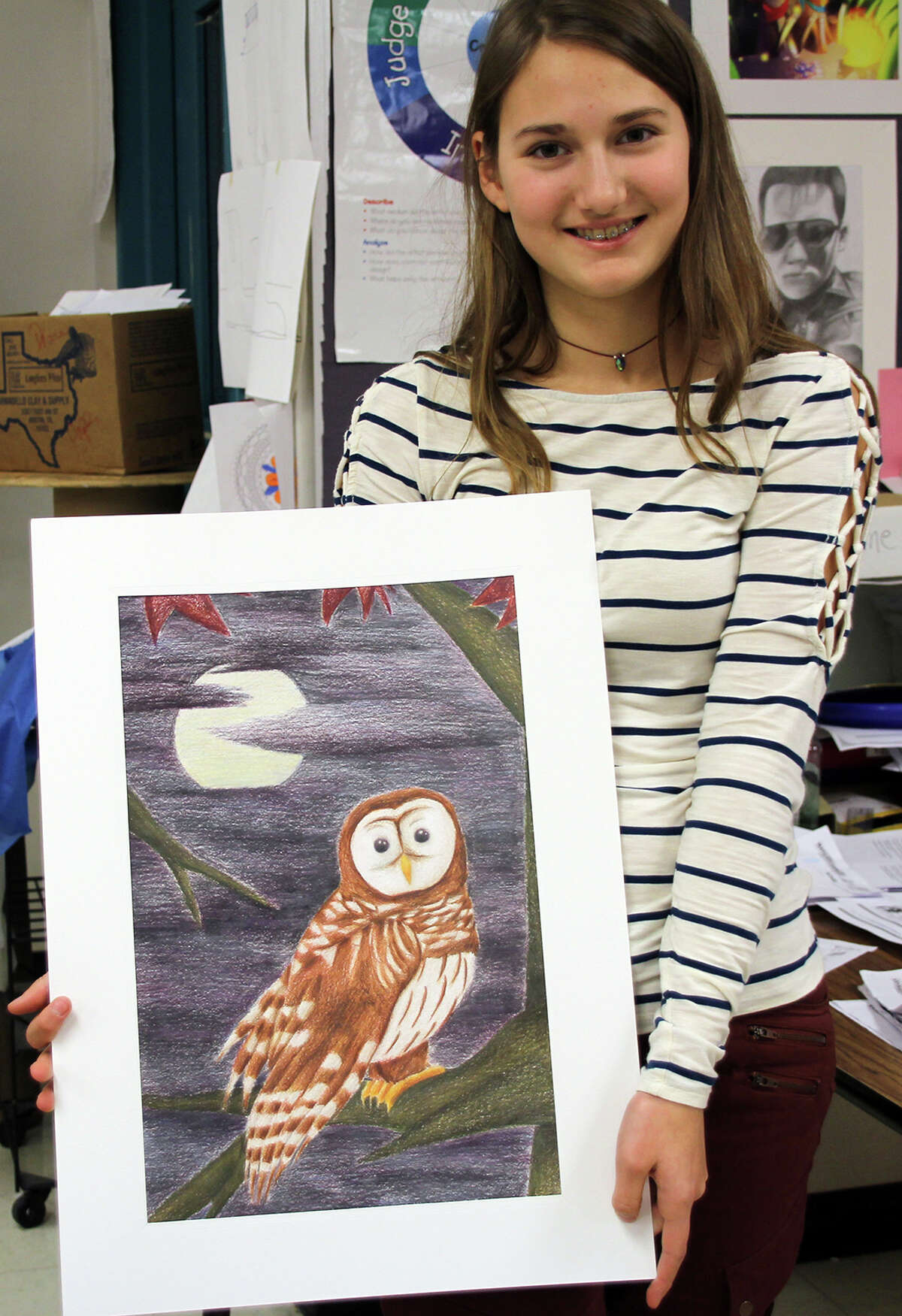 Huffman Middle School student, Lilly Barr, poses for a photo with her artwork for the Rodeo Art Show. She was awarded a gold medal for her submission in last year's Houston Livestock Show and Rodeo School Art Program.