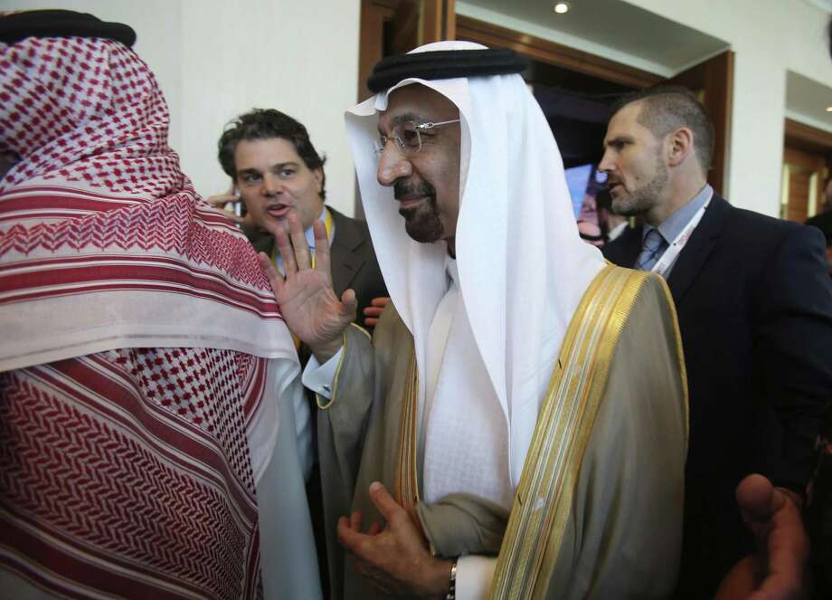 Saudi's oil minister, Khalid al-Falih, leaves after the opening ceremony Thursday of the Atlantic Council Global Energy Forum in Abu Dhabi, United Arab Emirates. Saudi Arabia has reduced oil production to less than 10 million barrels a day, below its targeted level, Energy Minister Khalid al-Falih said. Photo: Kamran Jebreili /Associated Press / Copyright 2017 The Associated Press. All rights reserved.