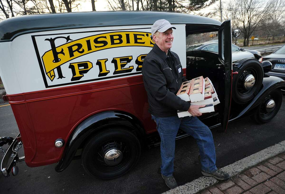 Dan O'Connor, of Fairfield, delivers a load of Frisbie Pies from his recently restored 1936 Chevy Sedan Delivery truck to Brooklawn Grocery & Deli at 652 Brooklawn Avenue in Bridgeport, Conn. on Wednesday, January 11, 2017. O'Connor has relaunched the company after purchasing the name rights to the original Bridgeport business, famous for the flying disc craze that began with the company's pie tins.
