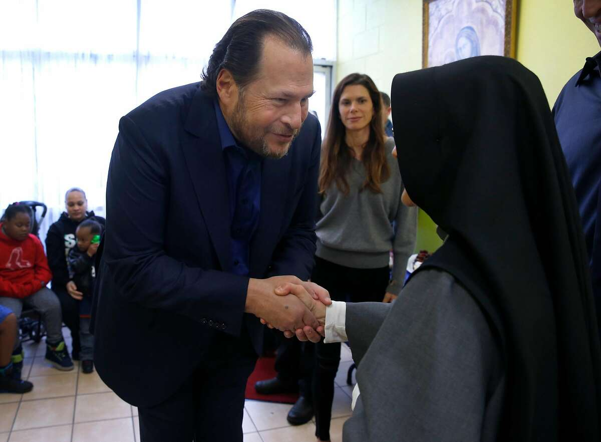 Salesforce CEO and philanthropist Marc Benioff meets with Sister Mary Valerie while his wife Lynne (center) looks on at the current Fraternite Notre Dame Mary of Nazareth House soup kitchen in San Francisco, Calif. on Thursday, Jan. 12, 2017. Self-improvement guru Tony Robbins stepped in to buy a new location for the nuns' soup kitchen at 16th and Mission streets after they were evicted from the current site on Turk Street and today the planning commission is voting whether to grant permission to allow the nuns to reopen the kitchen.