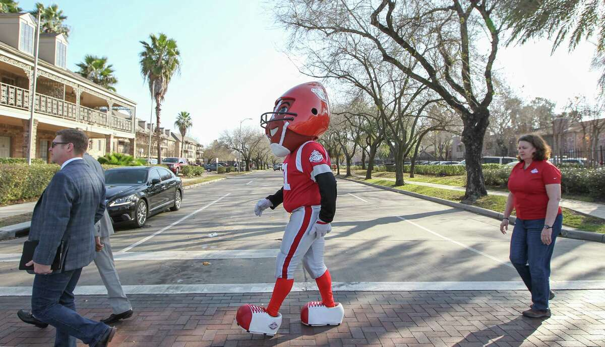 TD, Super Bowl 51 mascot walks down Broadway Street on his way to the Broadway/Hobby Corridor ribbon cutting ceremony Thursday, Jan. 12, 2017, in Houston. Scenic Houston and partners for the official Ribbon Cutting and press conference celebrating the Broadway/Hobby Corridor Redevelopment Project. See the transformation of this nearly two-mile long thoroughfare connecting Hobby Airport and Interstate 45. The Broadway Project has added nearly 410 live oaks and other trees in a partnership between Scenic Houston and Trees for Houston. Additional improvements include upgraded LED street lights, enhanced crosswalks, and cohesive landscaping and groundcover.