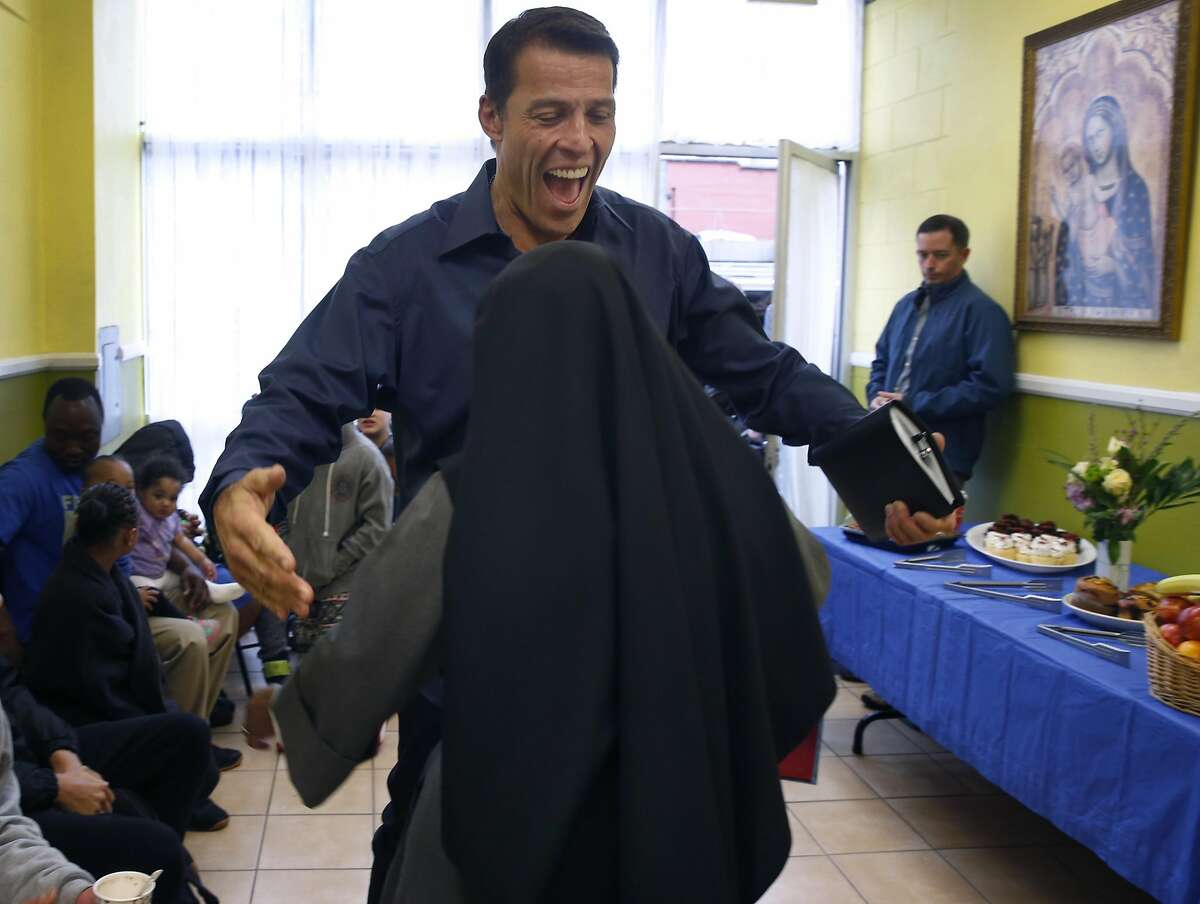 Tony Robbins offers a hug to Sister Mary of the Angels at the current Fraternite Notre Dame Mary of Nazareth House soup kitchen in San Francisco, Calif. on Thursday, Jan. 12, 2017. Robbins, the multi-millionaire self-improvement guru, stepped in to buy a new location for the nuns' soup kitchen at 16th and Mission streets after they were evicted from the current site on Turk Street and today the planning commission is voting whether to grant permission to allow the nuns to reopen the kitchen.
