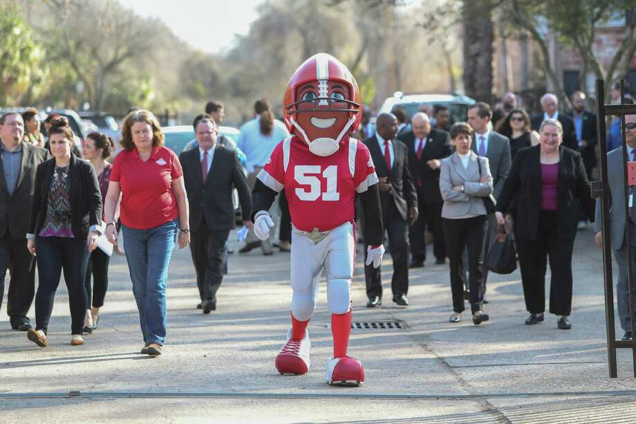 TD, Super Bowl 51 mascot leads attendees to the ribbon cutting ceremony Thursday, Jan. 12, 2017 in Houston.  Scenic Houston and partners for the official Ribbon Cutting and press conference celebrating the Broadway/Hobby Corridor Redevelopment Project. See the transformation of this nearly two-mile long thoroughfare connecting Hobby Airport and Interstate 45. The Broadway Project has added nearly 410 live oaks and other trees in a partnership between Scenic Houston and Trees for Houston. Additional improvements include upgraded LED street lights, enhanced crosswalks, and cohesive landscaping and groundcover. Photo: Steve Gonzales, Houston Chronicle / © 2017 Houston Chronicle