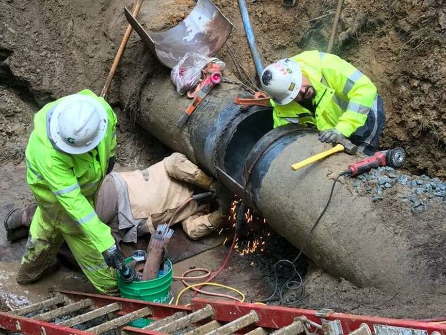 Crews work to repair a major water reservoir pipeline in the Santa Cruz Mountains that officials said sparked a water shortage for the city of Santa Cruz. Photo: City Of Santa Cruz Water Department / / City Of Santa Cruz Water Department