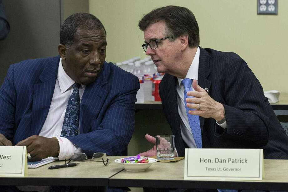 State Sen. Royce West, left, and Lt. Gov. Dan Patrick talk as state and local officials gather for an inquiry in July of 2015.  Republican Lt. Gov. Dan Patrick joined with state Sen. Royce West, D-Dallas, on Thursday to tout a bill that would create a $25 million grant program in the governor's criminal justice division for the effort. Photo: Brett Coomer, MBI / Associated Press / Houston Chronicle
