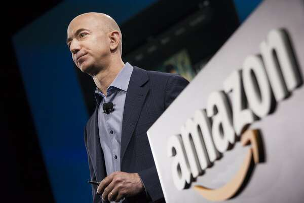 FILE - JANUARY 12: Amazon.com, the world's largest online retailer, said it will add 100,000 full-time U.S. employees over the next 18 months. SEATTLE, WA - JUNE 18: Amazon.com founder and CEO Jeff Bezos presents the company's first smartphone, the Fire Phone, on June 18, 2014 in Seattle, Washington. The much-anticipated device is available for pre-order today and is available exclusively with AT&T service.  (Photo by David Ryder/Getty Images)