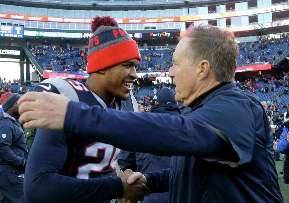 New England Patriots head coach Bill Belichick, right, speaks to defensive back Eric Rowe at midfield following an NFL football game against the New York Jets, Saturday, Dec. 24, 2016, in Foxborough, Mass. (AP Photo/Elise Amendola) Photo: Elise Amendola, Associated Press / Copyright 2016 The Associated Press. All rights reserved.