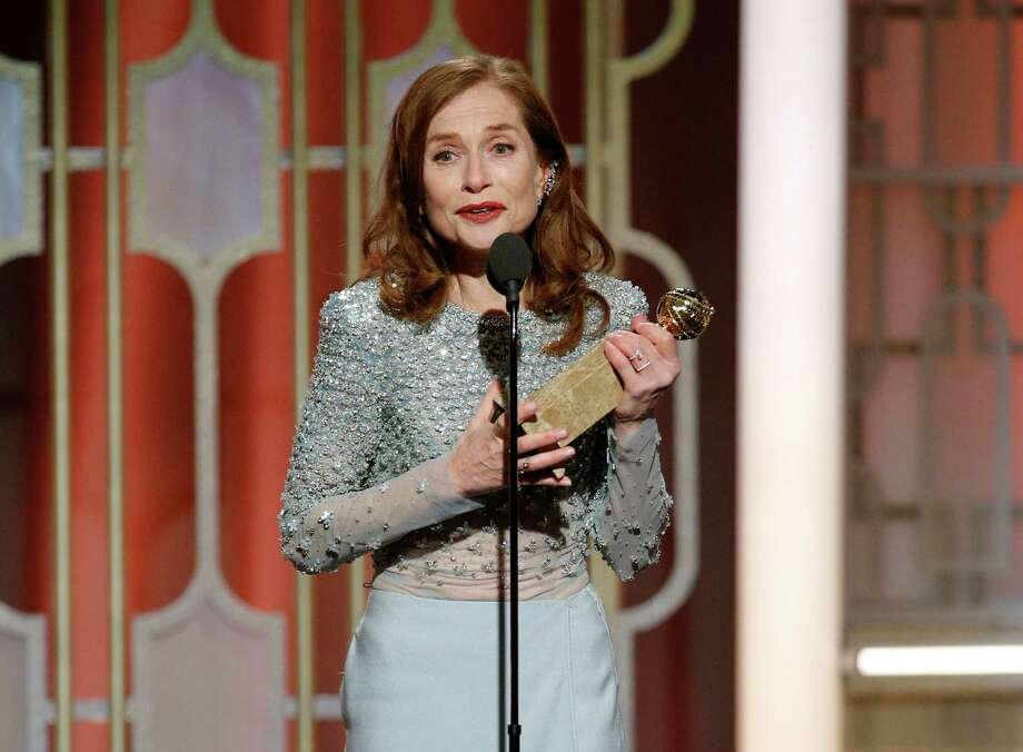 """This image released by NBC shows Isabelle Huppert accepting the award for best actress in a motion picture drama for her role in """"Elle"""" at the 74th Annual Golden Globe Awards at the Beverly Hilton Hotel in Beverly Hills, Calif., on Sunday, Jan. 8, 2017. (Paul Drinkwater/NBC via AP) ORG XMIT: NYET788 Photo: Paul Drinkwater / 2017 NBCUniversal Media, LLC"""