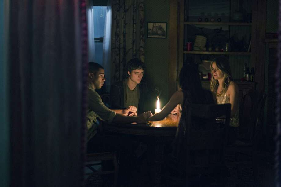 "Doug Jones / STX Productions Douglas Smith, Lucien Laviscount Jenna Kannell and Cressida Bonas worry about the words in ""The Bye Bye Man."""