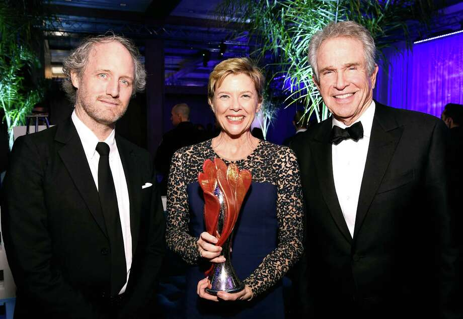 """Director Mike Mills joins """"20th Century Women"""" star Annette Bening and her husband, Warren Beatty, at the Palm Springs International Film Festival, where she received a lifetime achievement award. Photo: Getty Images / 2017 Getty Images"""
