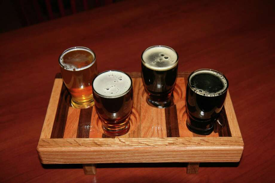 A sampler flight of the beers from Mad Pecker Brewing Company. Photo: Markus Haas /San Antonio Express-News / San Antonio Express-News