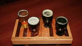 A sampler flight of the beers from Mad Pecker Brewing Company.