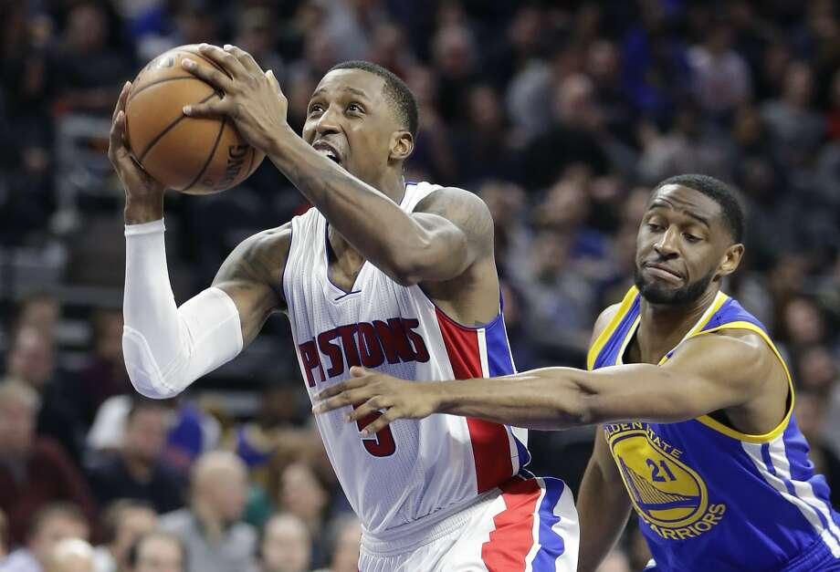 44dfff75ffc4 Golden State Warriors guard Ian Clark (21) reaches in on Detroit Pistons  guard Kentavious