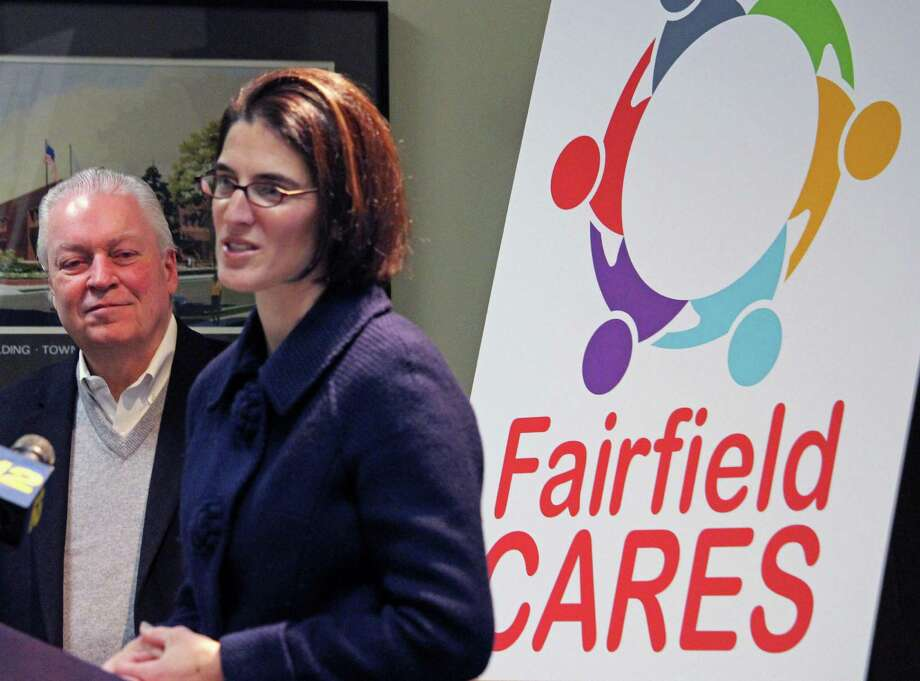 First Selectman Mike Tetreau and State Rep. Cristin McCarthy Vahey speak at the Fairfield Cares Community Coalition press conference Monday at police headquarters. Photo: Genevieve Reilly / Hearst Connecticut Media / Fairfield Citizen
