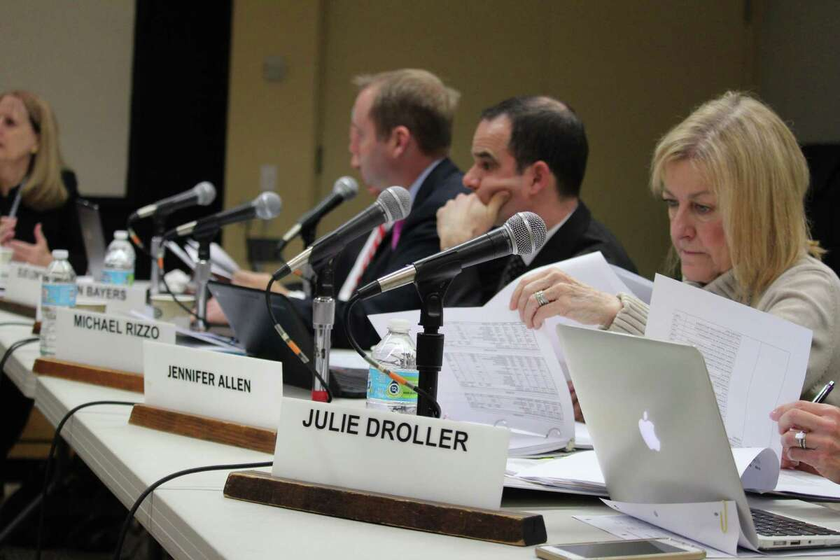 Jennifer Allen, director of secondary education, looks closely at the budget during the Board of Education's work session on Jan. 6.
