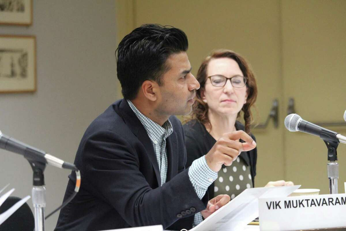 School board member Vik Muktavaram asks a question at their day-long work session.