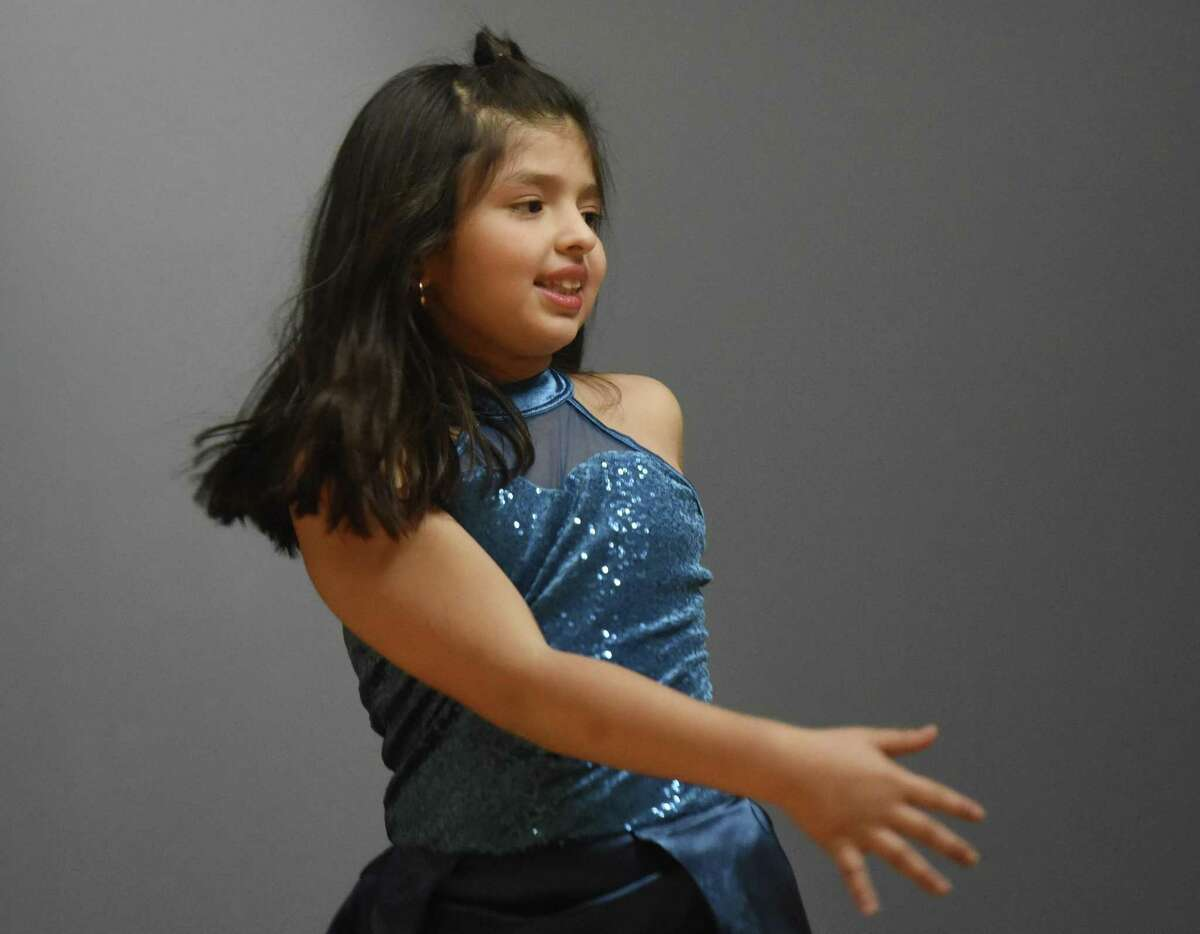 Camila Stellato, 8, of Westport, performs a dance routine during the Latino Foundation of Stamford's annual Three Kings Celebration '17 at the DOMUS Center in Stamford Jan. 8.
