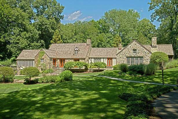 The stone and stucco English country manor house at 102 Valley Road was designed and built in 1937 by legendary architect Frazier Foreman Peters.