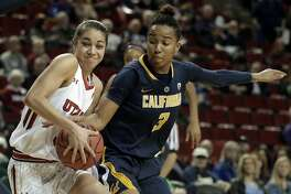 California forward Mikayla Cowling, right, tries to strip the ball from Utah forward Malia Nawahine, left, in the second half of an NCAA college basketball game in the Pac-12 Conference tournament, Thursday, March 3, 2016, in Seattle. California beat Utah 66-63 in overtime. (AP Photo/Ted S. Warren)