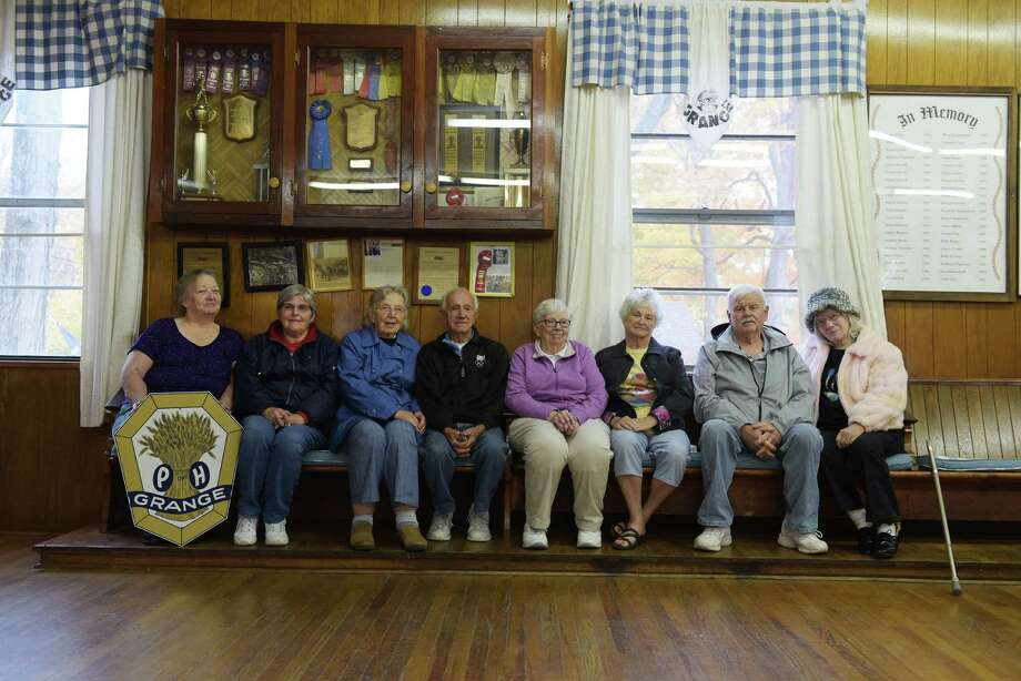 Glenville Grange members from left to right, Marie Skidmore, Ann Barr, Fran Hahn, Harold Hahn, Betty Conde, Lois Hayner, Robert Barr, and Liz Morin, pose for a photo inside the Grange hall on Thursday, Oct. 20, 2016, in Amsterdam, N.Y.  The members of the Grange have decided to sell the grange hall.    (Paul Buckowski / Times Union) Photo: PAUL BUCKOWSKI / 20038448A