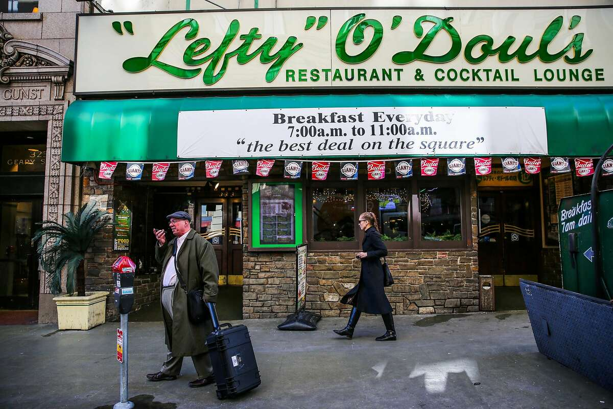 People walk past Lefty O'Doul's restaurant in San Francisco, Calif., on Thursday, January 12th, 2017. The restaurant announced it will be closing and relocating.