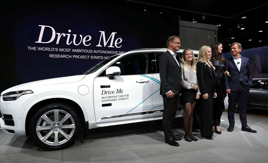 DETROIT, MI - JANUARY 9: Hakan Samuelsson (R), President and CEO, Volvo Car Group, stands with the Hain family from Sweden next to the autonomous Volvo vehicle they will be testing at the 2017 North American International Auto Show on January 9, 2017 in Detroit, Michigan. Approximately 5000 journalists from around the world and nearly 800,000 people are expected to attend the NAIAS between January 8th and January 22nd to see the more than 750 vehicles and numerous interactive displays. (Photo by Bill Pugliano/Getty Images) Photo: Bill Pugliano/Getty Images